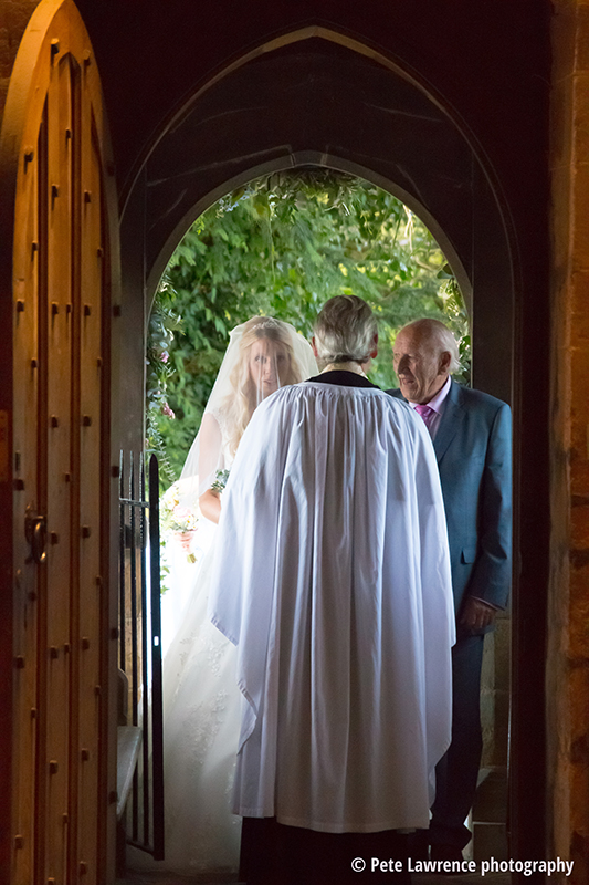 bride-and-father-waiting-to-walk-down-isle