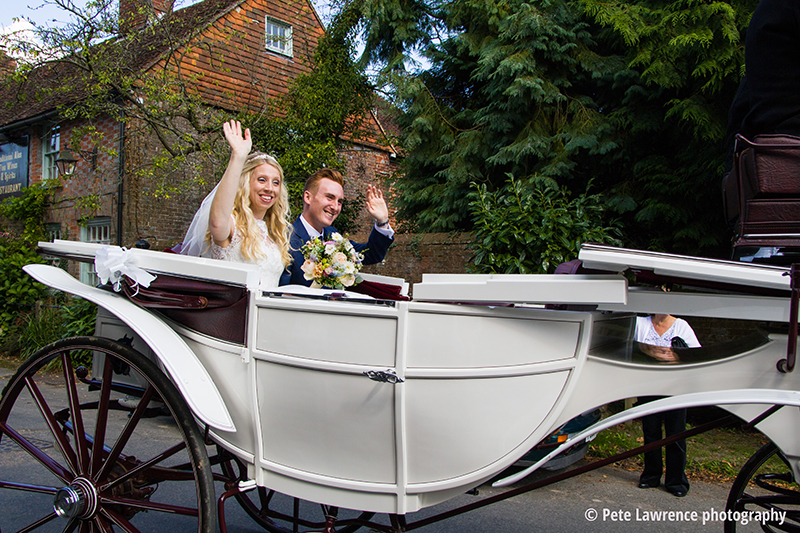 bride-and-groom-in-horse-and-carrage